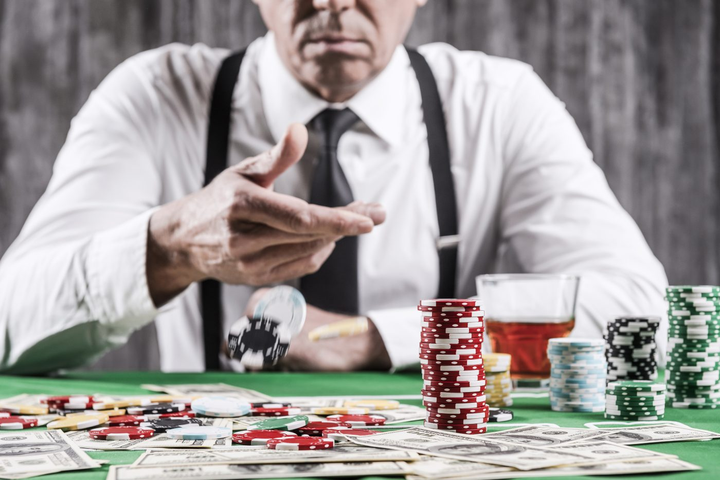man playing poker - going concern
